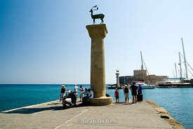 Platoni Statue at enterance to Mandraki Harbour, Rhodes, Dodecanese Islands, Greece.