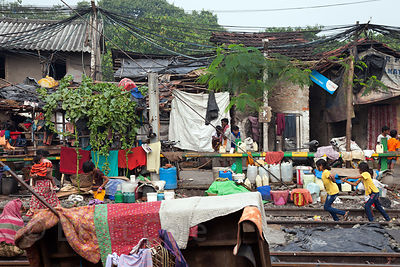 A slum area on the railway tracks near New Alipore Station, Kolkata, India. Many slum areas in Kolkata focus on an industry, like laundry here. Train activity is much less in Kolkata than in Mumbai. I don't think something like this could exist in Mumbai.