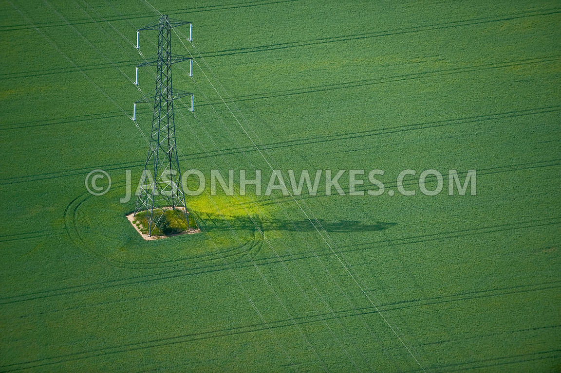 Aerial view of electric pylons through countryside