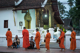 Early morning alms giving to monks in Luagprabang, Laso.