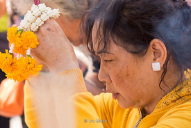 A woman praying at Erawan Shrine in Bangkok, Thailand.