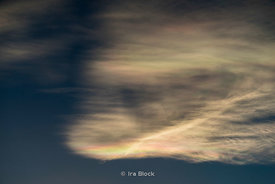 Iridescenced Clouds in Tibet near Tingri, and not far from Mt. Everest. The rainbow looking clouds are caused by ice crystals at high altitude.