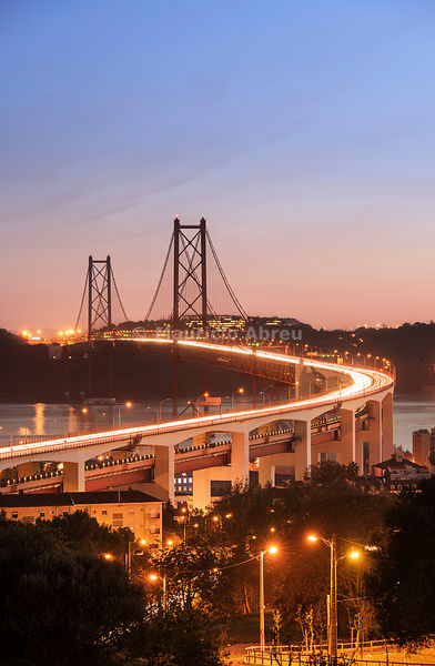 25 de April bridge (similar to the Golden Gate bridge) across the Tagus river at dusk. Lisbon, Portugal