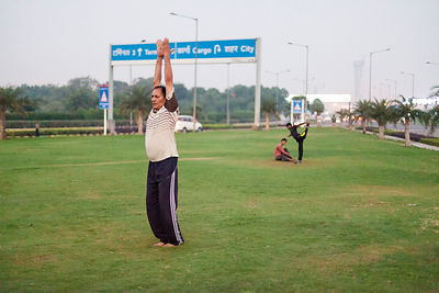 India - New Delhi - A man exercises on the private traffic greens at Aerocity near Terminal 3 of Indira Gandhi Airport,