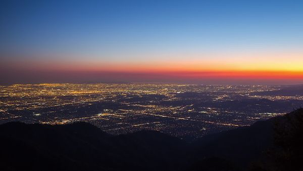 Bird's Eye: Remnants of Sunlight & High Cloud Mist Over a Lit Los Angeles at Dusk