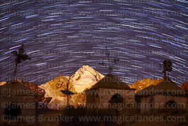 Star trails over Mt Huayna Potosí and Milluni cemetery, Cordillera Real, Bolivia