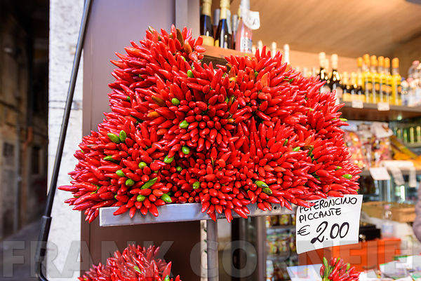 Red peppers for sale on a market stall in Venice, Italy.