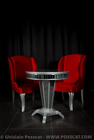 red armchairs with table