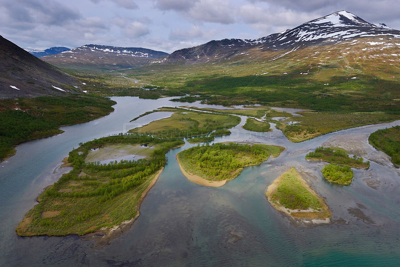 Aerial view of mountainous valley with small islands in the Vietasatno River, Stora Sjofallet National Park, Greater Laponia Rewilding Area, Lapland, Norrbotten, Sweden, June 2013.