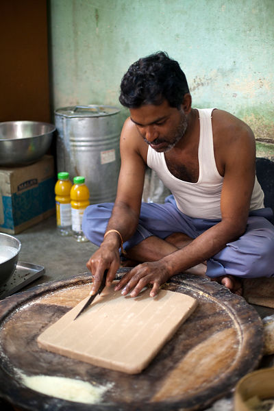 India - Chandannagar - A man making sweets at Modak and Grandsons sweet shop