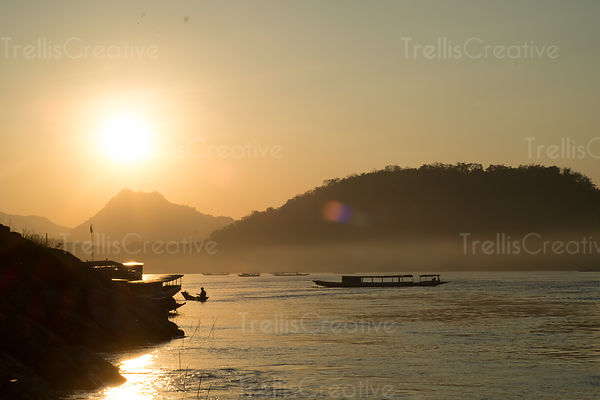 Silouttes of boats on the mekong river