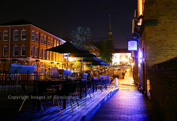 A bar, looking towards the Jewellery Quarter in Birmingham, UK. St Pauls Church in backgrouond