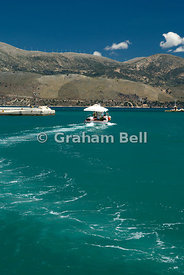 Fishing boat leaving harbour, Lixouri, Kefalonia, Ionian Islands, Greece.