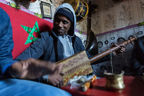 Musician Playing a Traditional Instrument in the Old Medina