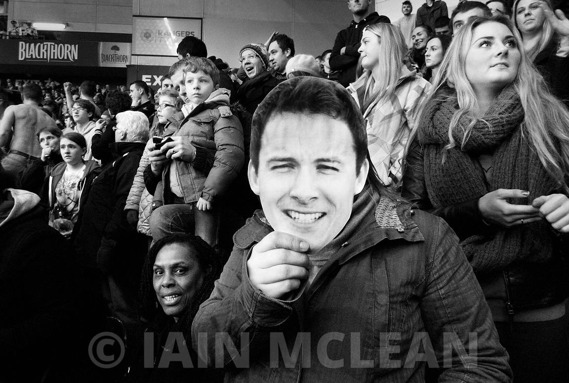 Ibrox Stadium.9.3.14.Scottish Cup Quarter Final.Rangers 1-1 Albion.Rangers level with a dubious goal with 12 minutes remaining.Scott Chaplain mask held by a supporter....Picture Copyright:.Iain McLean,.79 Earlspark Avenue,.Glasgow.G43 2HE.07901 604 365.photomclean@googlemail.com.www.iainmclean.com.All Rights Reserved.
