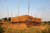 House building with mud bricks. Butare region, Rwanda.