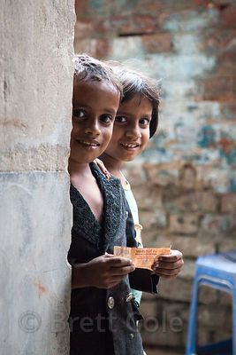 Portrait of two children in the Fakir Bagan area of Howrah, India