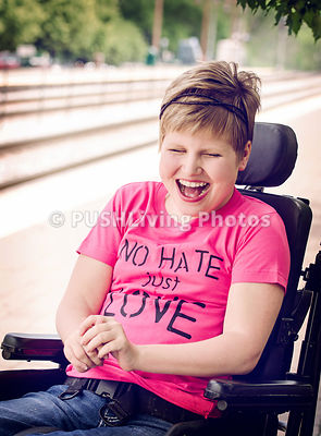 Portrait Of Disabled Girl Laughing Sitting On Wheelchair