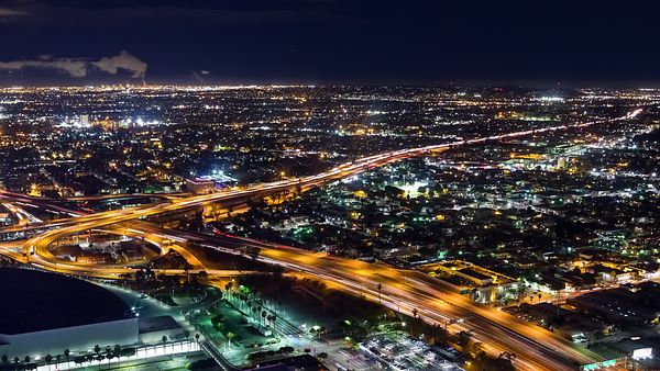 Bird's Eye: Los Angeles Interchange With a Marine Layer in the Background, at Night