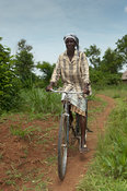 Rural adviser with her bicycle, which she uses to travel between communities with. Bumala, Kenya.