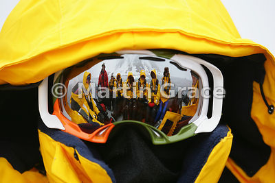 Polar tourists on a Zodiac inflatable reflected in the visor of one of the passengers, Moffen Island, Wijdefjorden, Spitsbergen