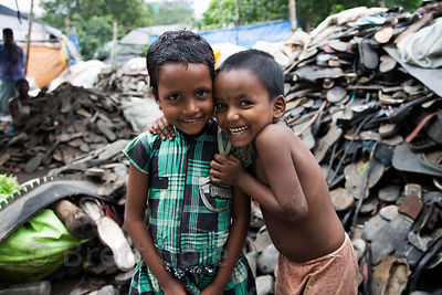 Children working at a rubber shoe recycling operation, Dhapa, Kolkata, India. Dhapa is a large industrial zone that processes most of Kolkata's garbage and recycling.