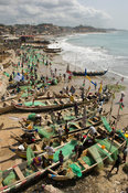 View of the beach from Cape Coast Castle, old gold and slave trading centre. Fishing piroges lying on the beach, Cape Coast, Ghana