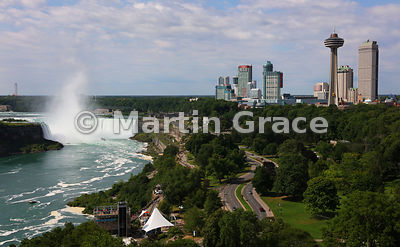 Canadian Horseshoe Falls and tourist high-rise buildings with the Skylon Tower prominent in the foreground, Niagara Falls, Ontario, Canada