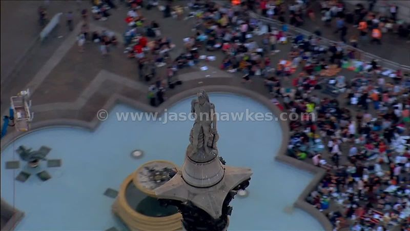 Aerial footage of Trafalgar Square at dusk, London, England, UK