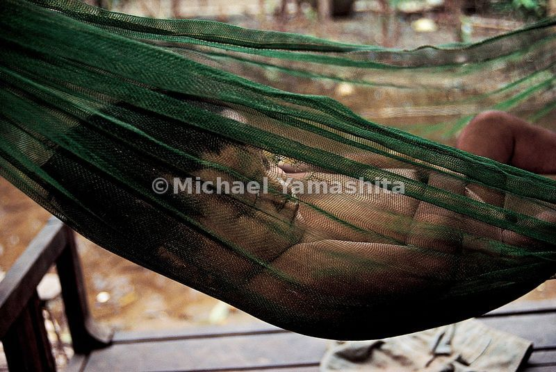 A baby sleeps, cradled in a fishing net in Siem Riep.