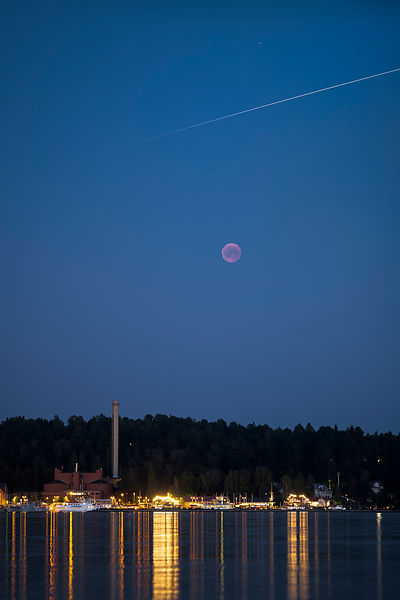 Total Lunar eclipse and the International Space Station (ISS) above the harbour of Lahti on July 27 2018.