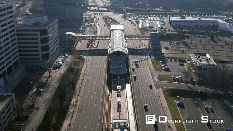 Tysons, Virginia, USA. Stationary tilt centered over Greensboro Metro platform and Leesburg Pike as train arrives