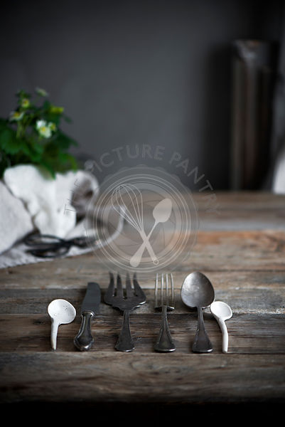 Cutlery in a row on a table