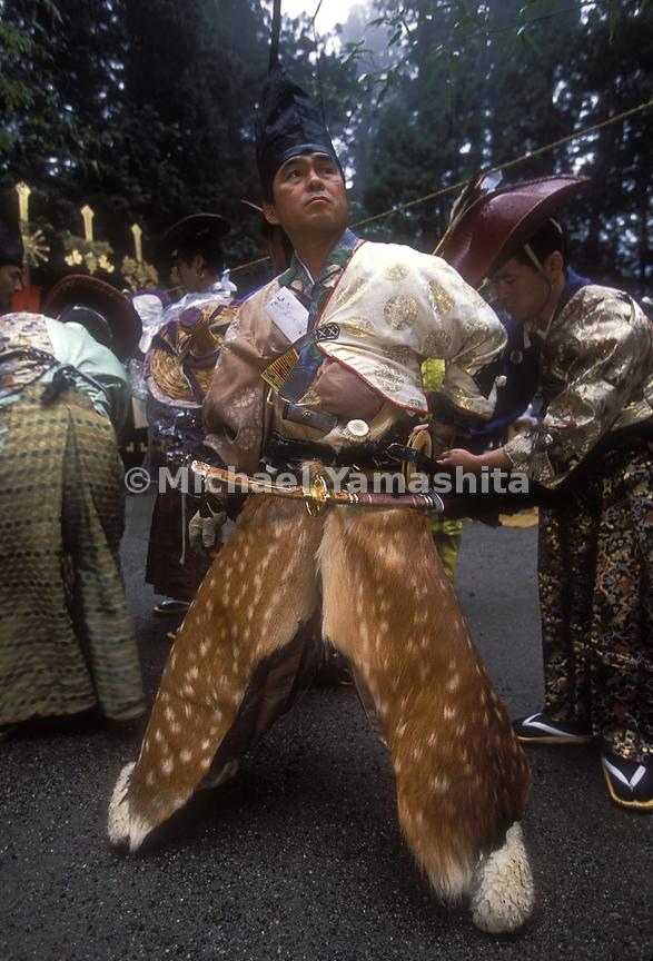 Deerskin chaps are part of one mans uniform at Nikko Toshuga Festival.