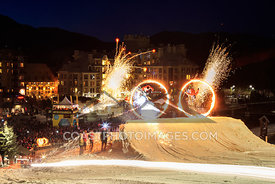 April 10, 2016: Whistler BC. Skiers jump through flaming hoops during Whistlers weekly Fire and Ice show at the base of Whistler Mountain. Photo by Mitch Winton - coastphoto.com