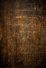 Background of dirty and scratched vertical wood.