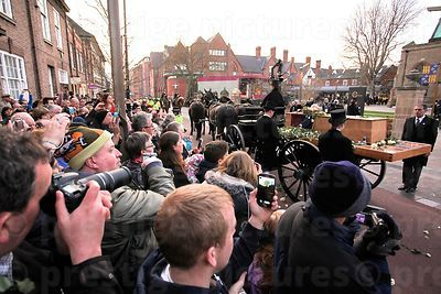The Watching Crowd Look on as Undertakers Observe a Silence by the Coffin for Richard III