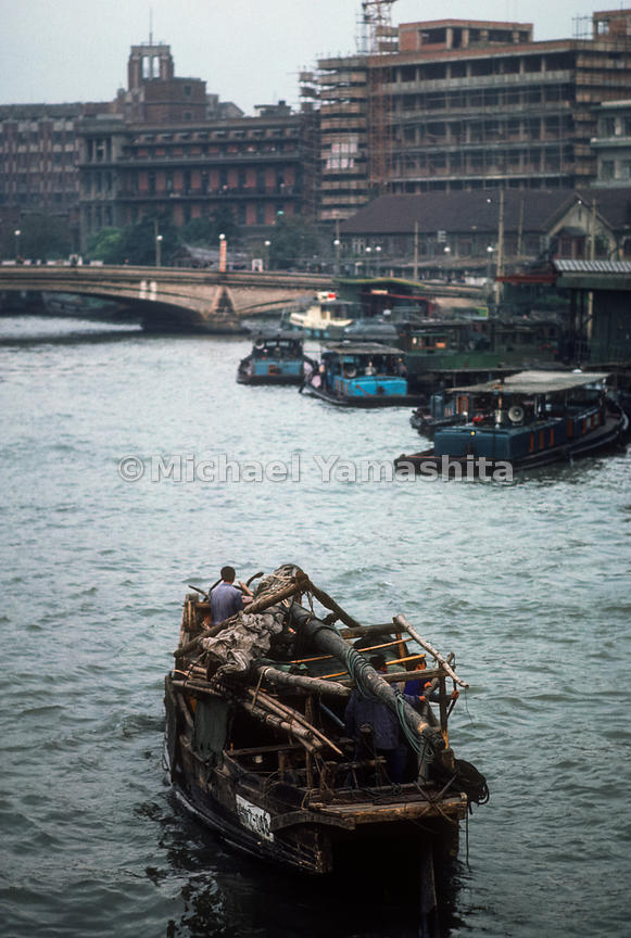 Boats on the Grand Canal in Shanghai, China.