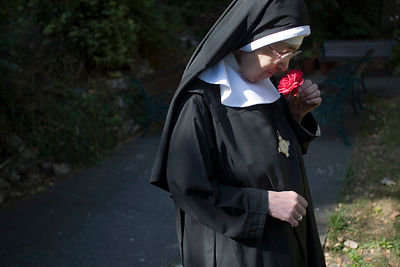 Mother Noelle with a rose