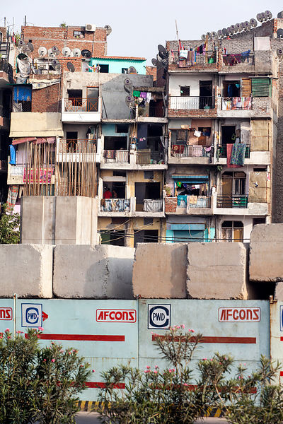 India - New Delhi - Housing next to a new road construction