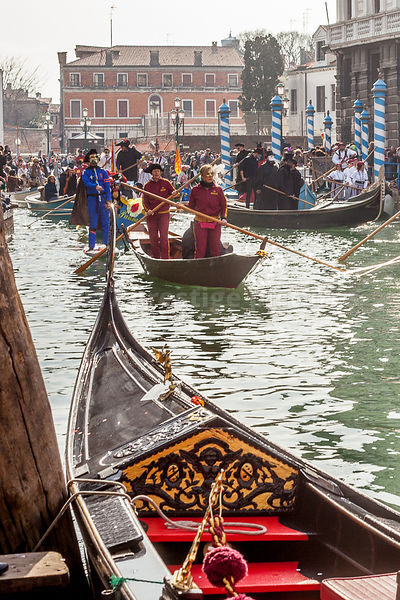 Moored Gondola in the Foreground as Boats pass by in the Venice Carnival Water Parade