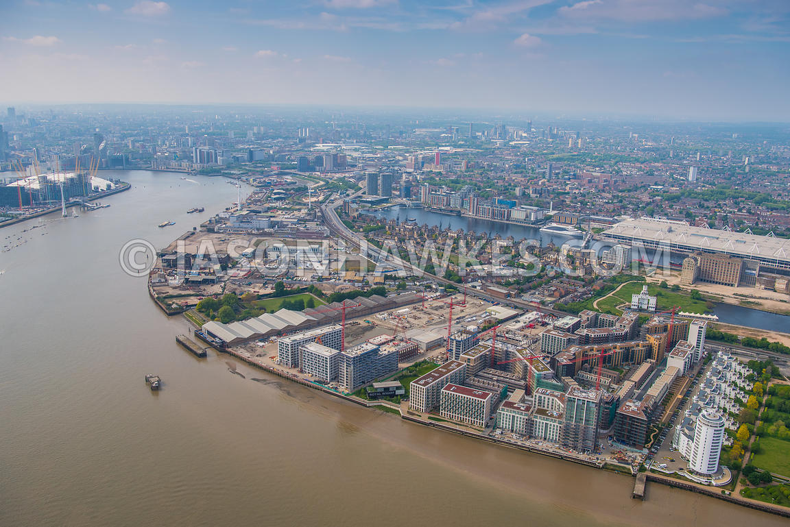 Aerial view over Silvertown, London. Britannia Village (West Silvertown) (London), Excel centre, london, Lyle Park, Peruvian Wharf, Pontoon Dock, Royal Victoria Dock, Royal Wharf, Silvertown, Thames Barrier Park, The Royal Docks