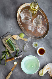 Matcha wine cocktail prep. Photographed from front view on a grey background.