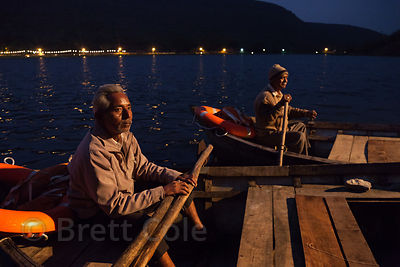 Boats arrive to carry candles out to the water for Deepdan at Sukh Mahal in Bundi, Rajasthan, India