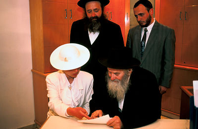 Israel - Jerusalem - A Rabbi helps the Bride to sign the Wedding record