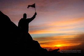 Climber with Flag from Mount Kinabalu