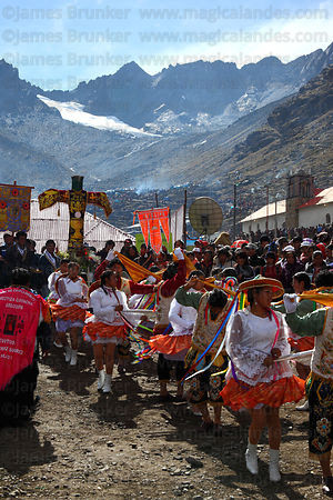 Dance group dancing at cross at end of trail to the Sanctuary, Qoyllur Riti festival, Peru