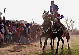 This photograph of a nihang warrior showing of his balancing skills on the ground during the holla mohalla festival was shot in Anandpur sahib.