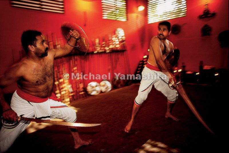 Combatants in Calicut demonstrate Kalaripayatta, which was developed in India in the 12th century and exported to China, where Shaolin Temple monks adapted it into Kung Fu.