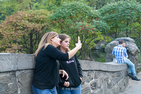 People taking selfies in Central Park in Manhattan, New York City.